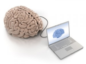 Brain Training - Image of a Brain Connected to Laptop